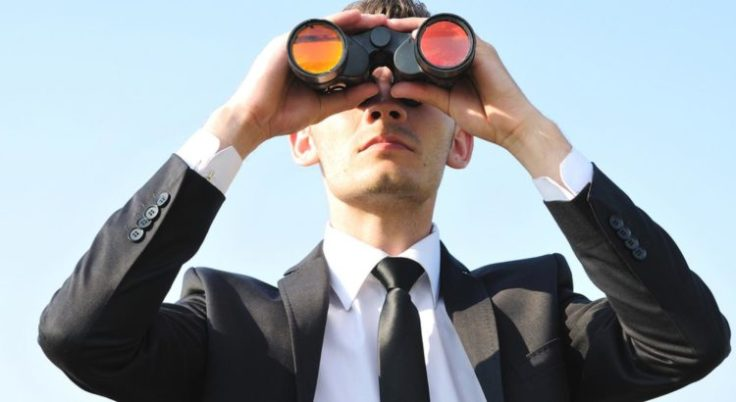business_man_with_binoculars_on_sky-750x410